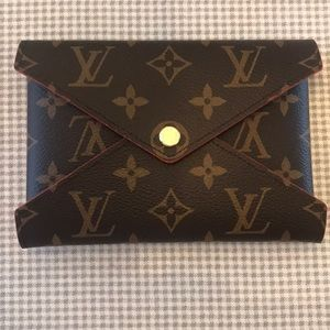 Louis Vuitton medium Kirogami snap pouch.
